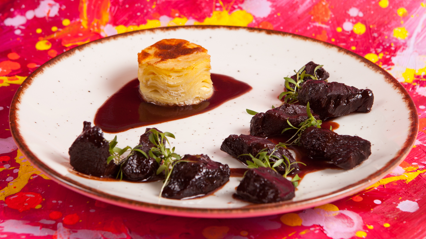 Slow cooked beef cheeks in red wine and herbs
