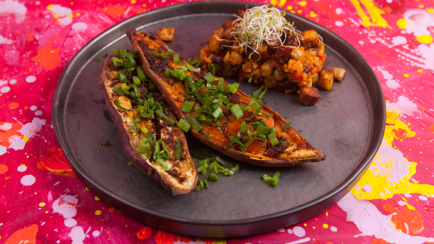 Baked sweet potato with red miso, served with red pepper, onions, leek and celery