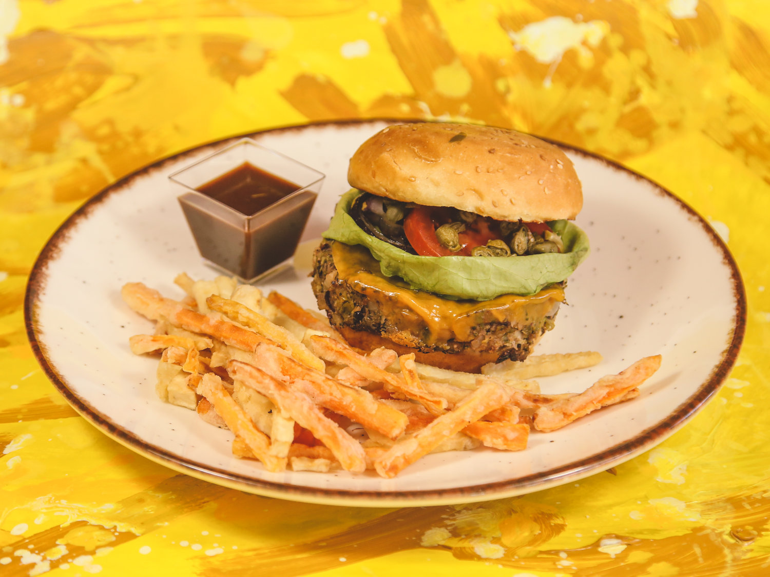 Vegetarian Burger on a pumpkin butter spread with our authentic homemade BBQ sauce, served with celery and carrot French fries
