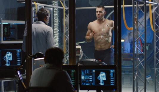 man being monitored running on treadmill