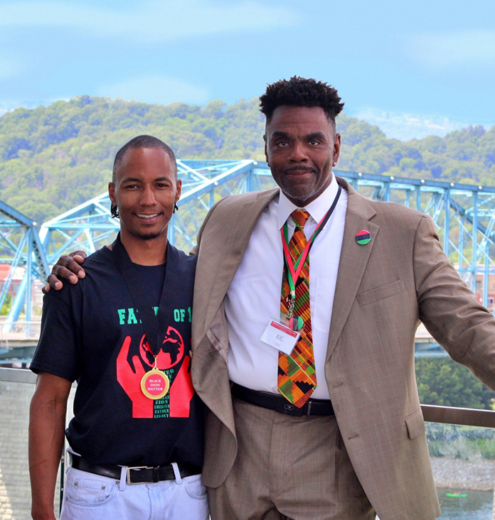 ChattaNAP founder Ricardo Morris standing and smiling with Walnut Street Bridge in the background.