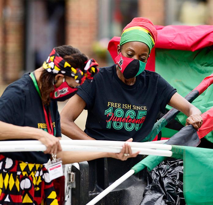 Two Chattanooga Neighborhood Arts Partnership volunteers working at the Black Arts & Ideas festival.