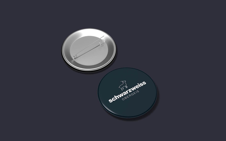 Anstreckbuttons mit Logo Gestaltung für schwarzweiss obergeis