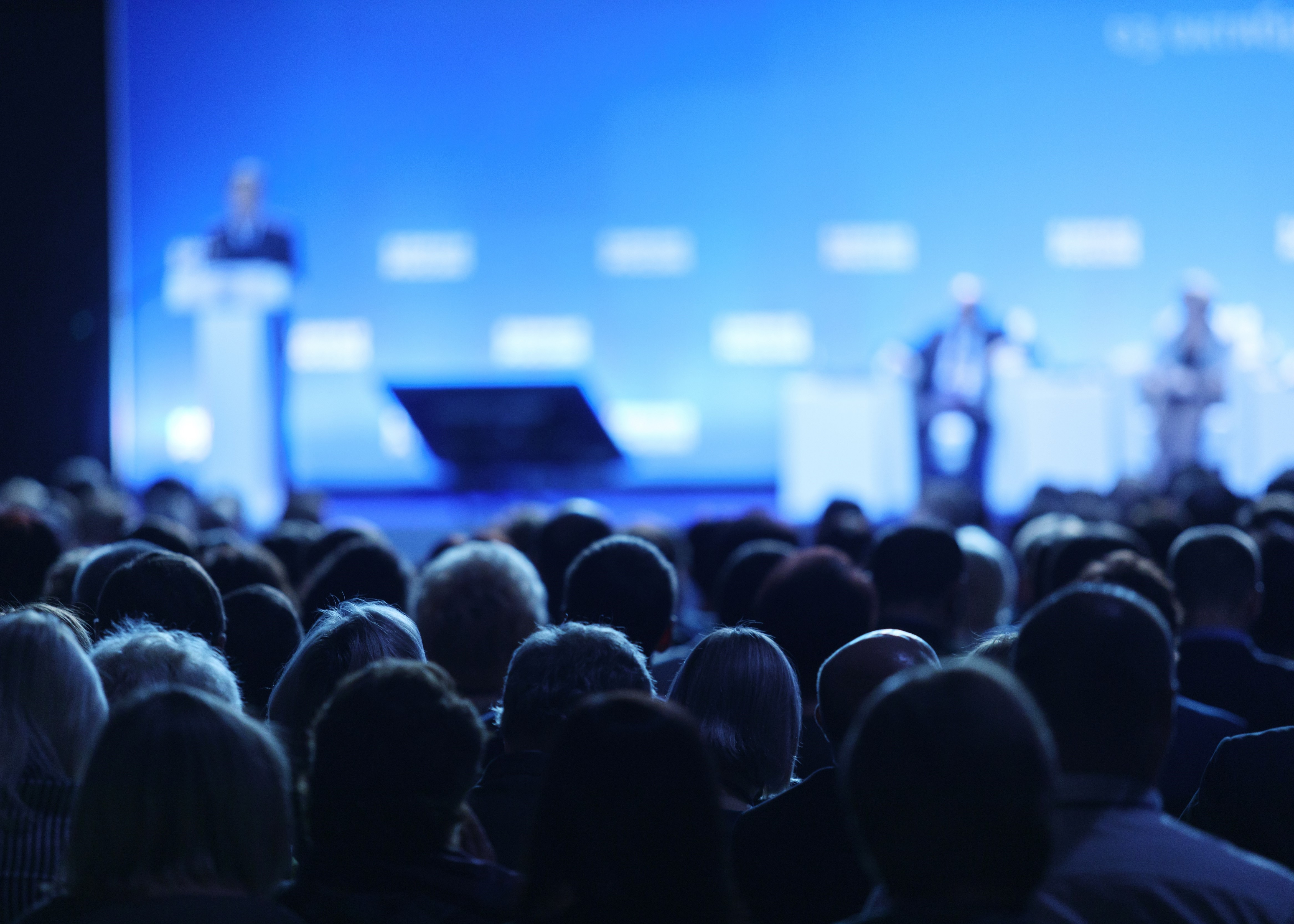 audience watching speaker presenting