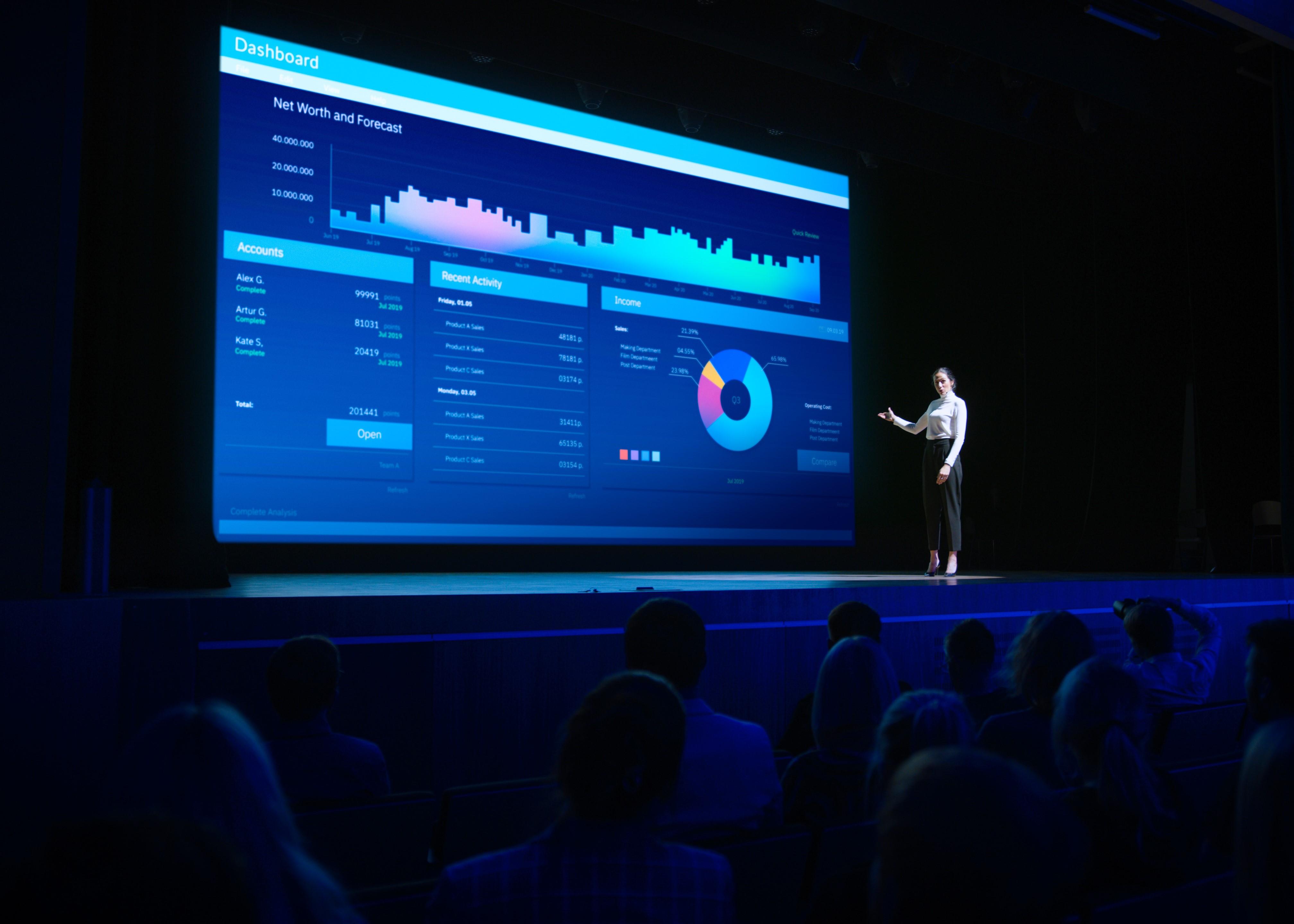speaker giving presentation blue screen