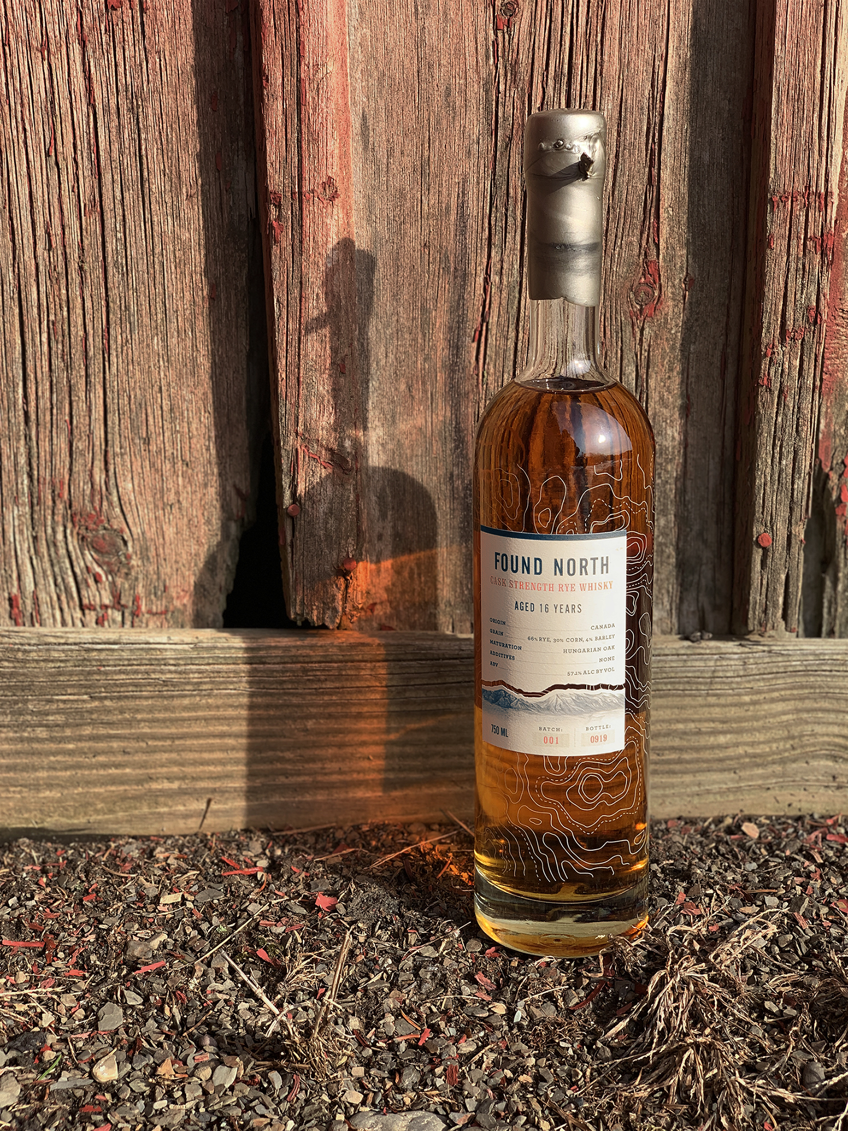 Thumbnail image of Batch 001 Cask Strength Rye Whisky in front of a shed