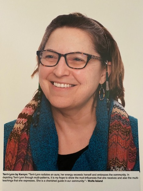 A head full colour head shot of the author Terri-Lynn wearing glasses with a green and grey beaded glasses chain.
