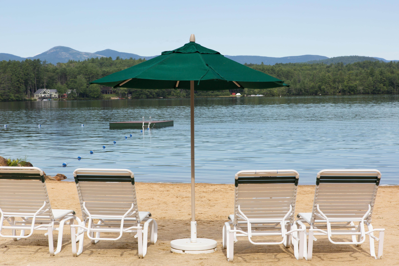 Beach chairs, umbrella, lake and the dock