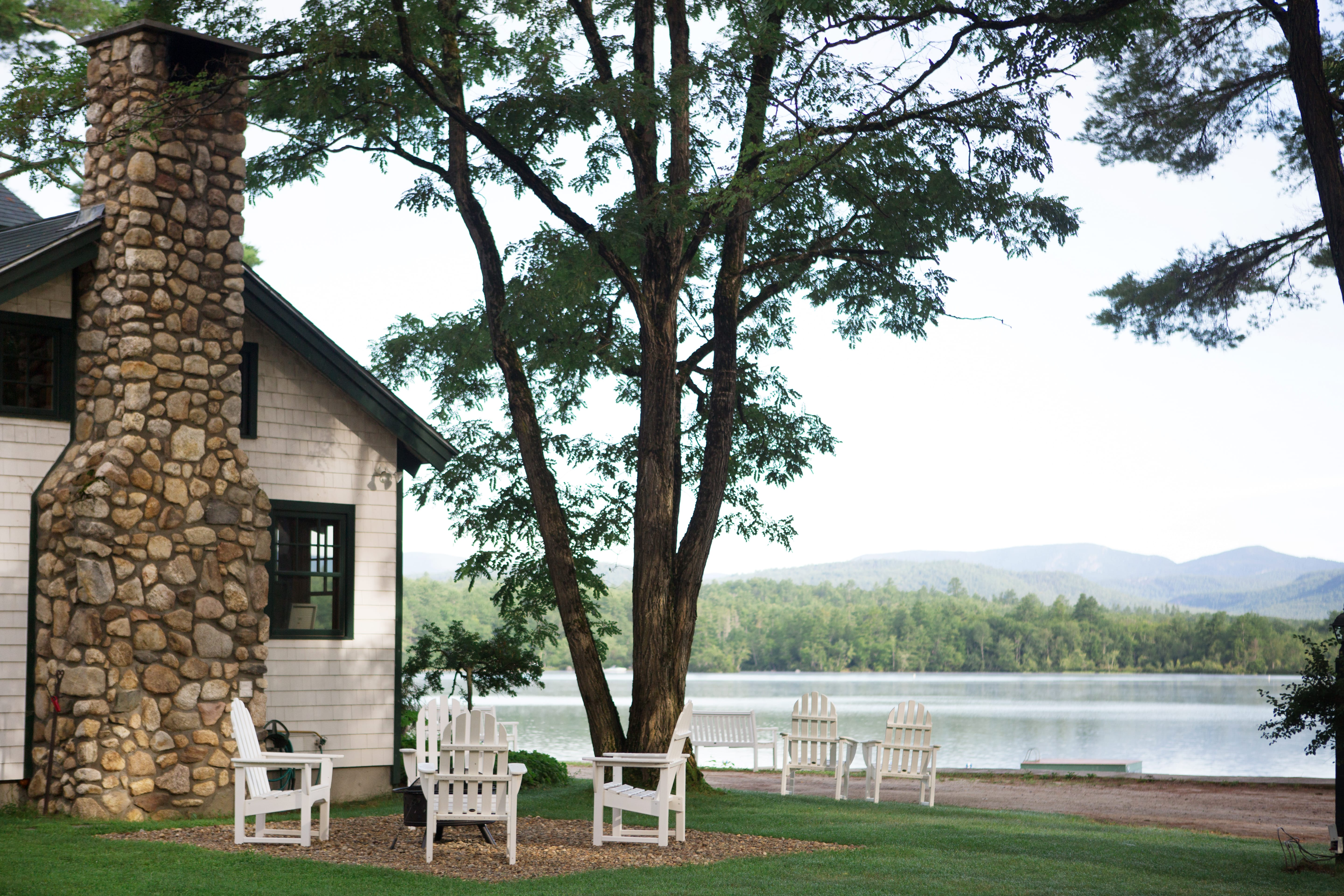 View of cabin chairs and lake