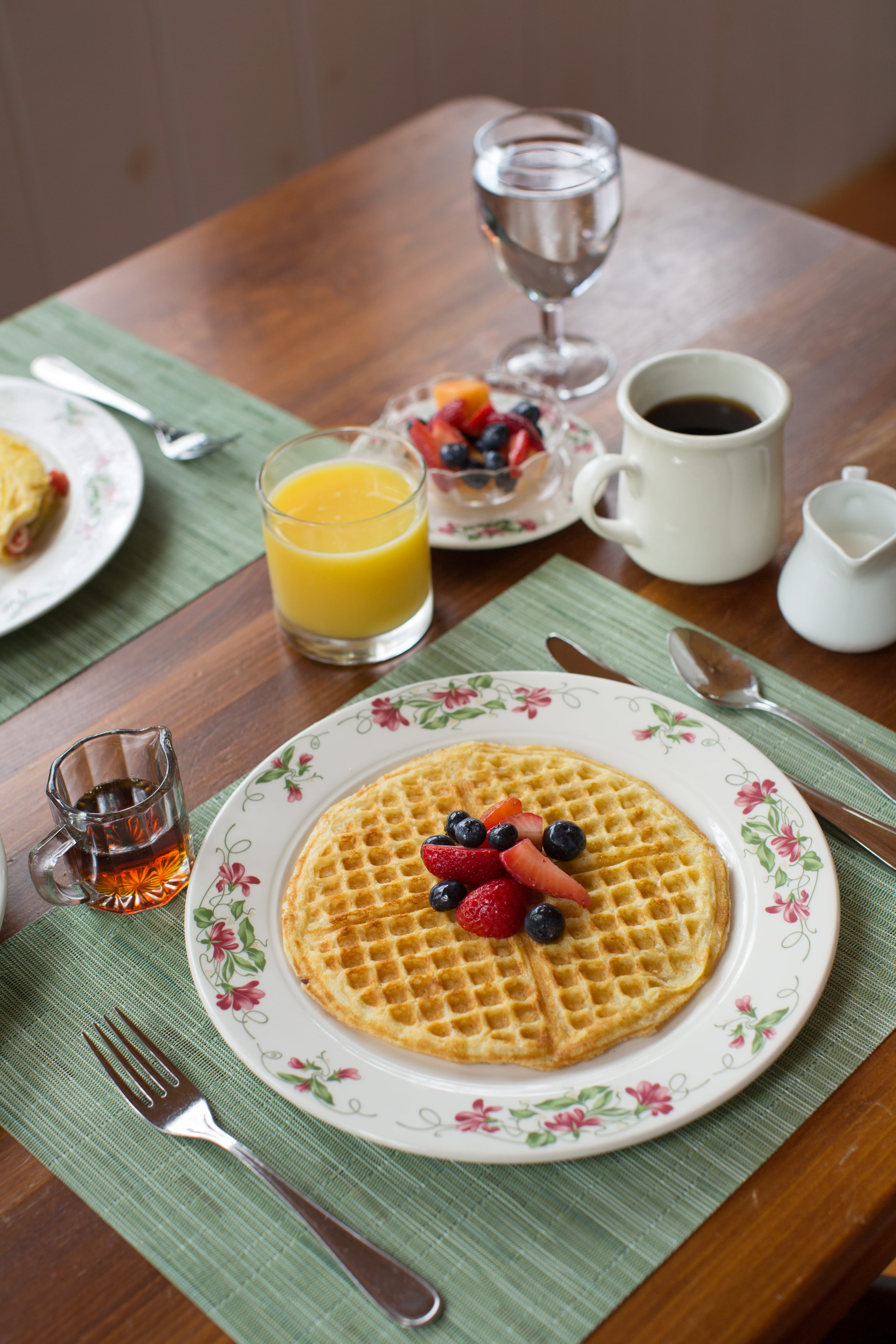 Image of breakfast meal with waffle and coffee