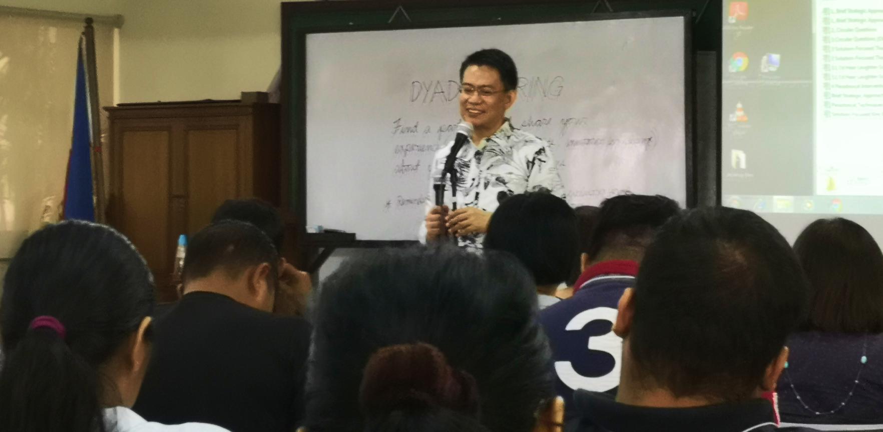 A professor teaching in class