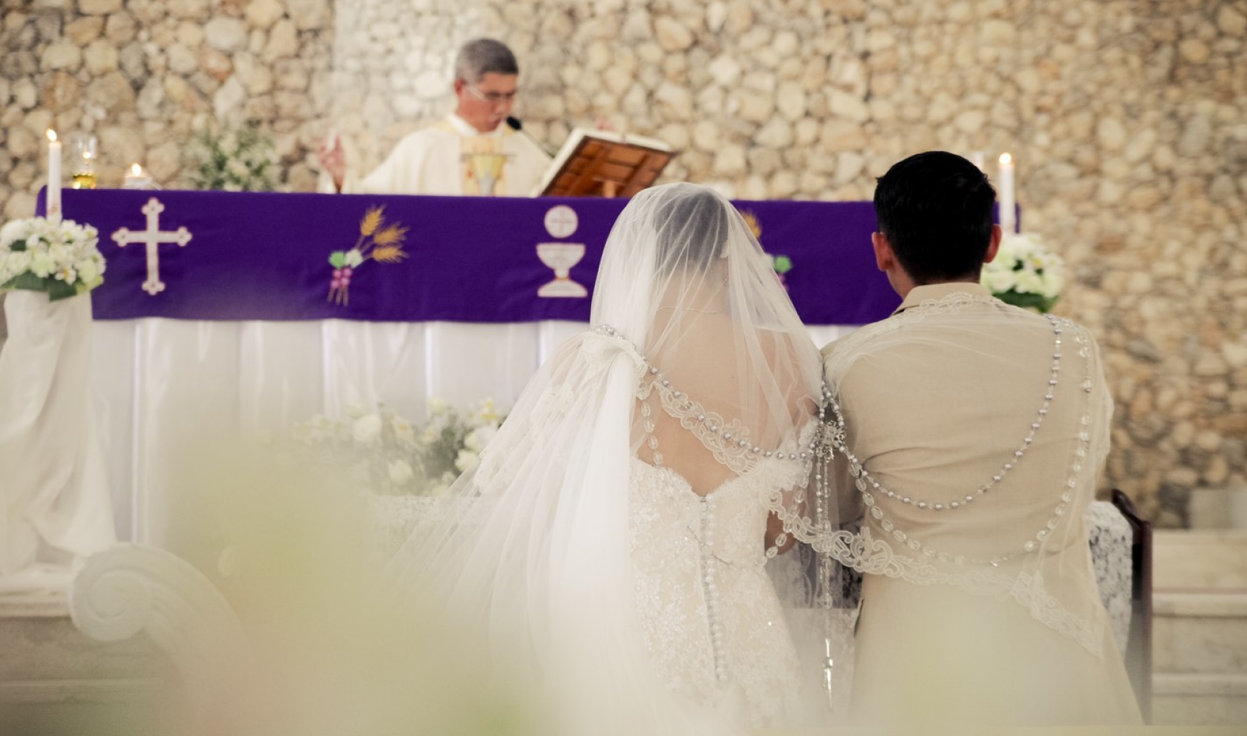 A wedding ceremony where the priest is delivering his message