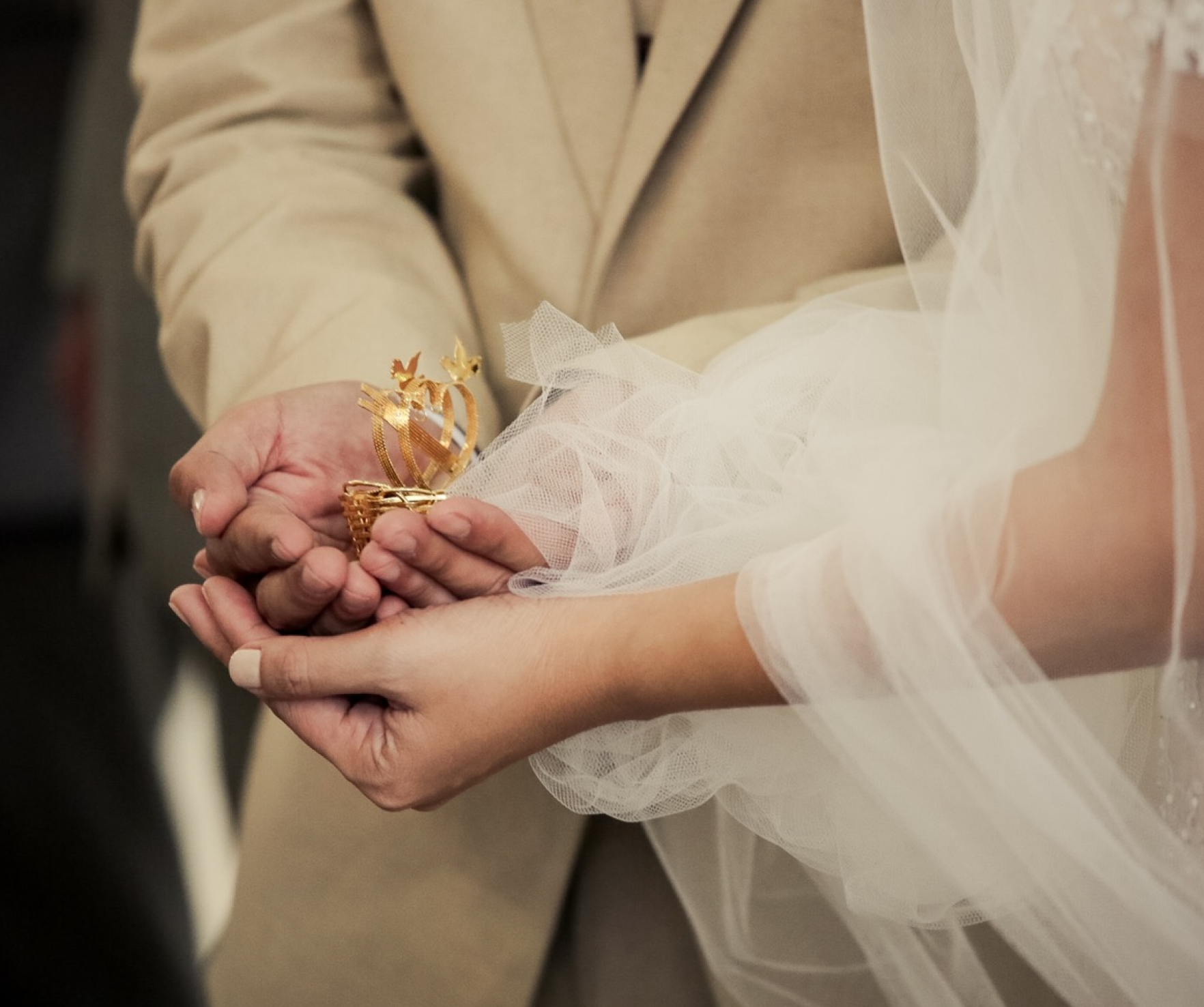 A wedding ceremony where the couple is holding hands