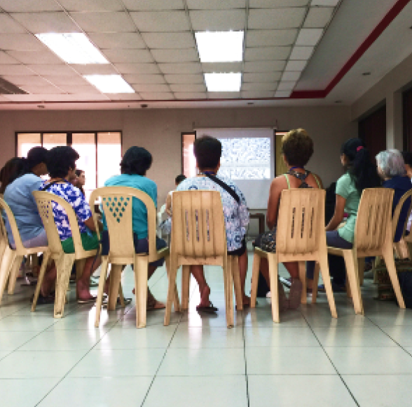 Participants of the Daluyan program are seated and listening to the program.
