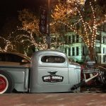 The Anvil & Hammer Agency hotrod riding on the square in Denton.