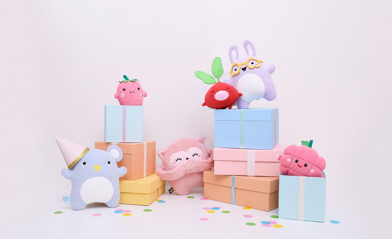 Noodoll toys standing on present boxes