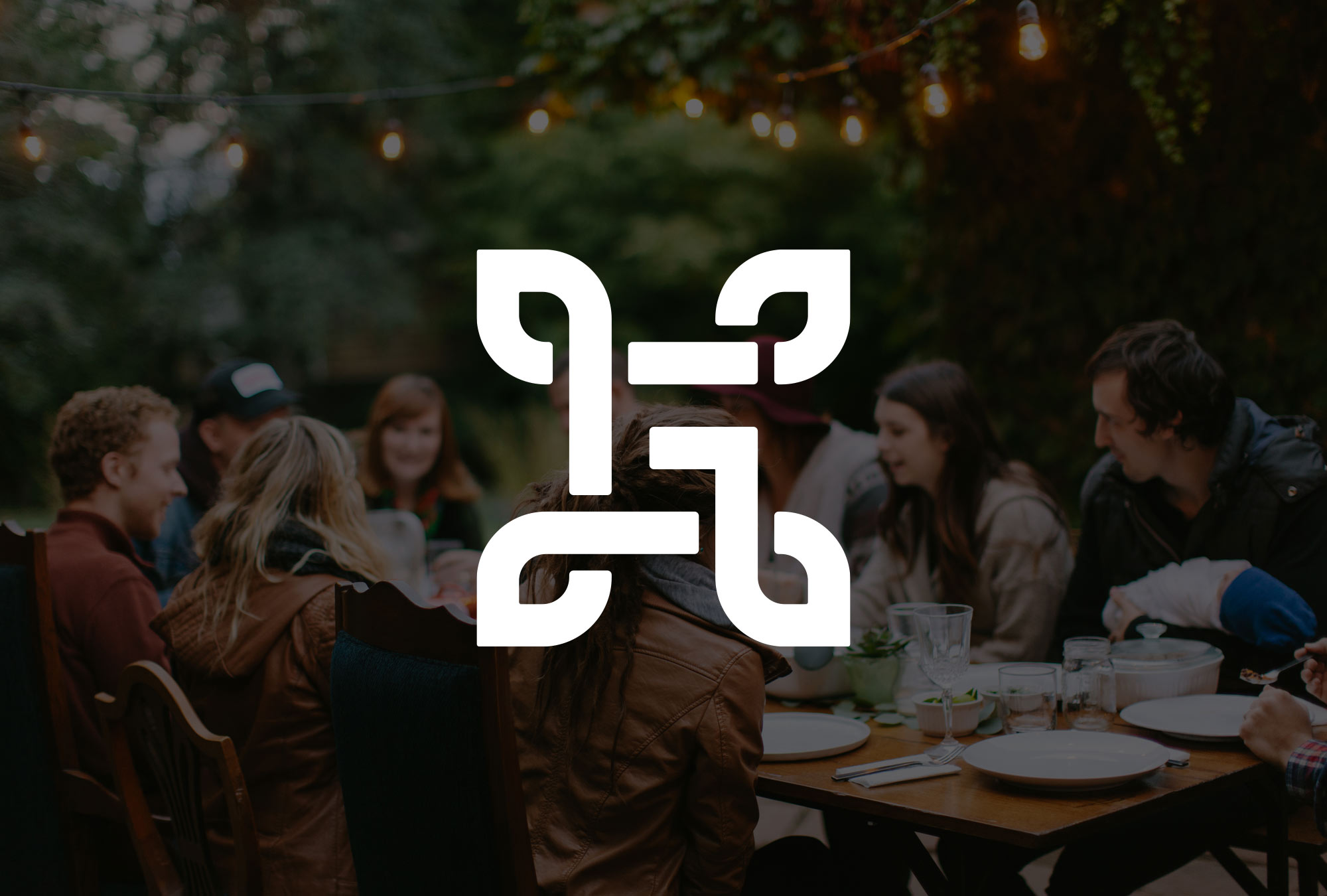 The Grove Church logo on a photo background of family and friends sitting around an outdoor table