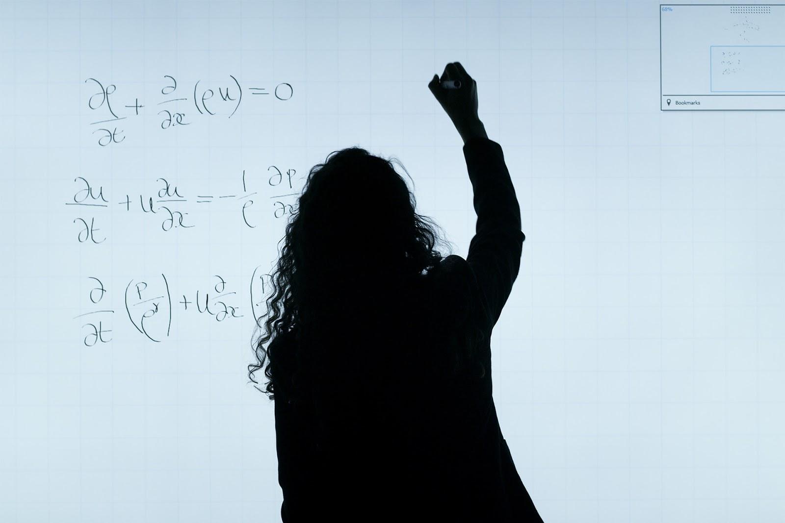 woman solving math problems