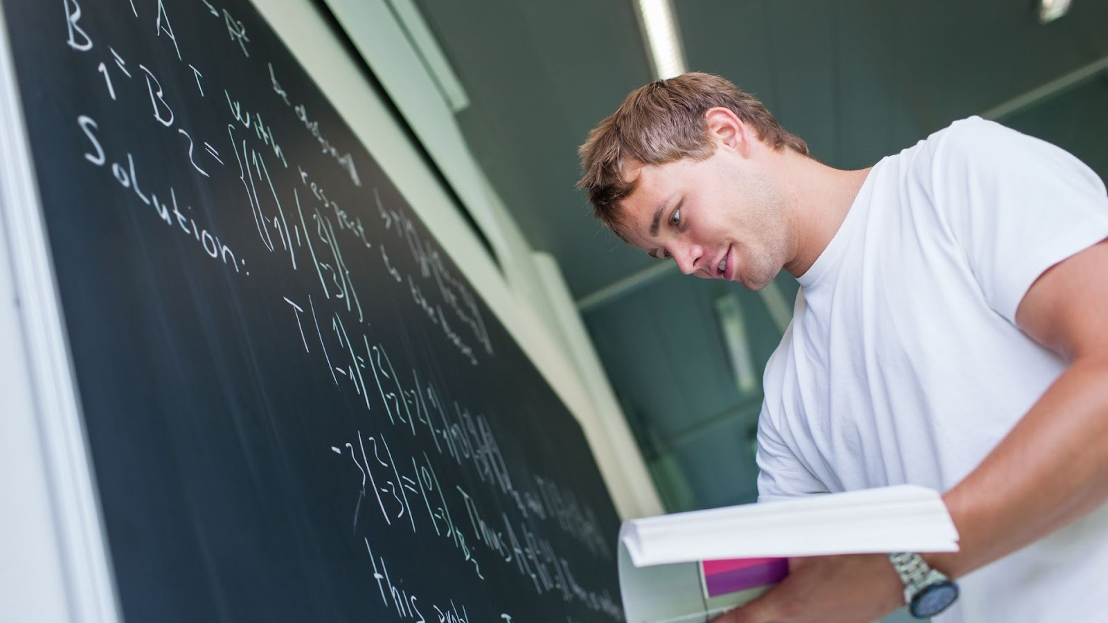 male student solving a math equation