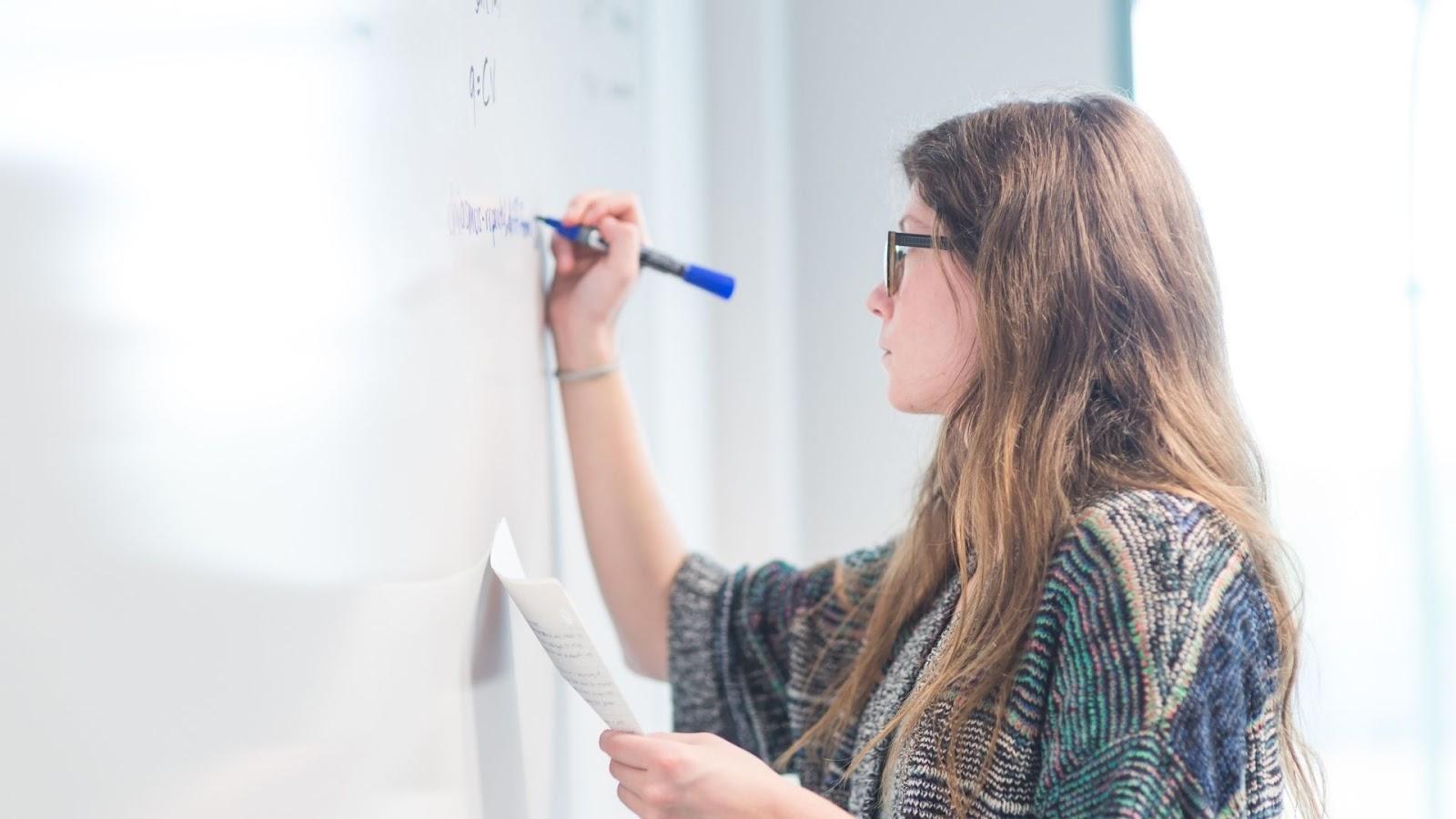 female student solving a math problem