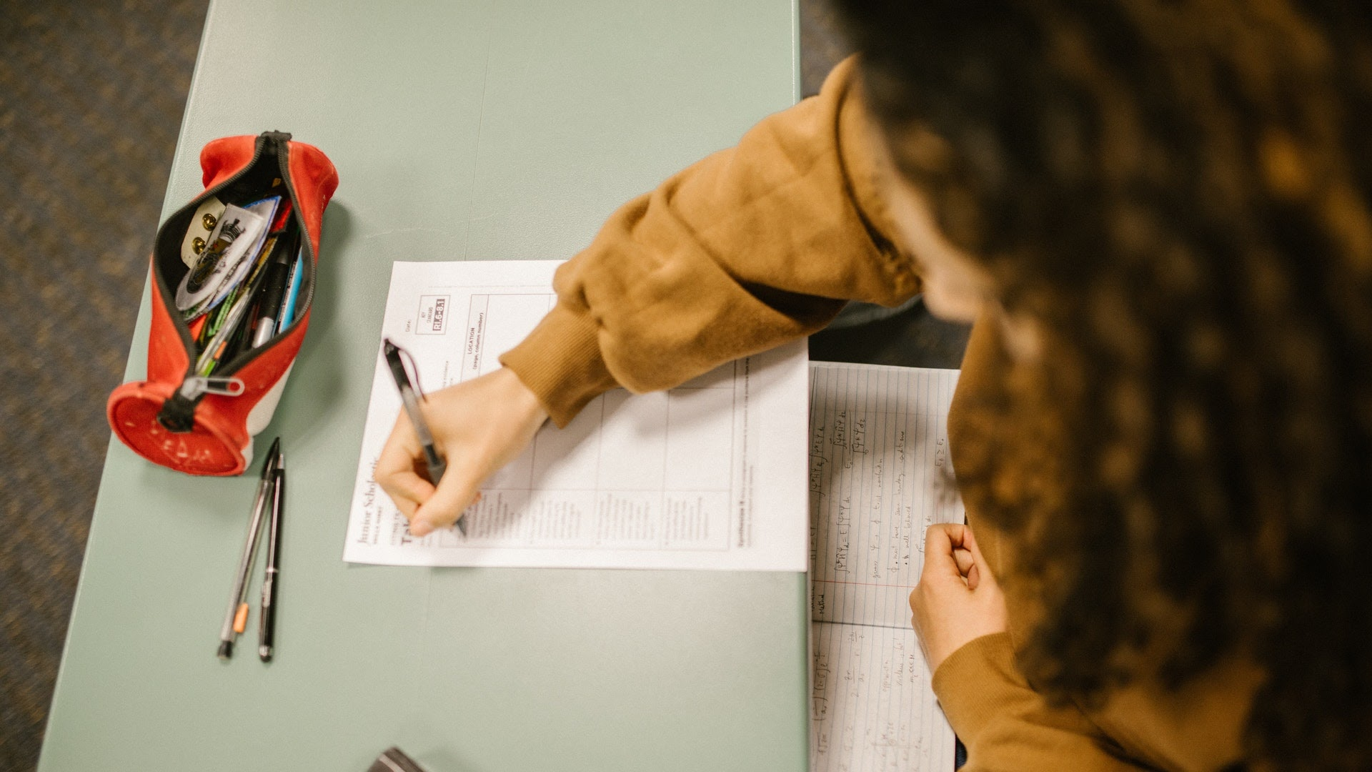 female student taking ACT test