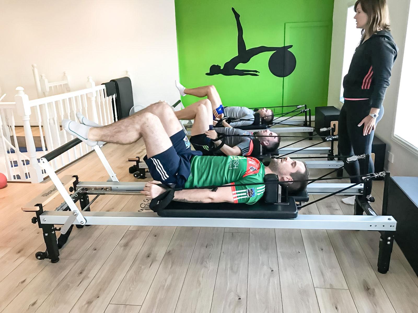 Men doing rehab pilates