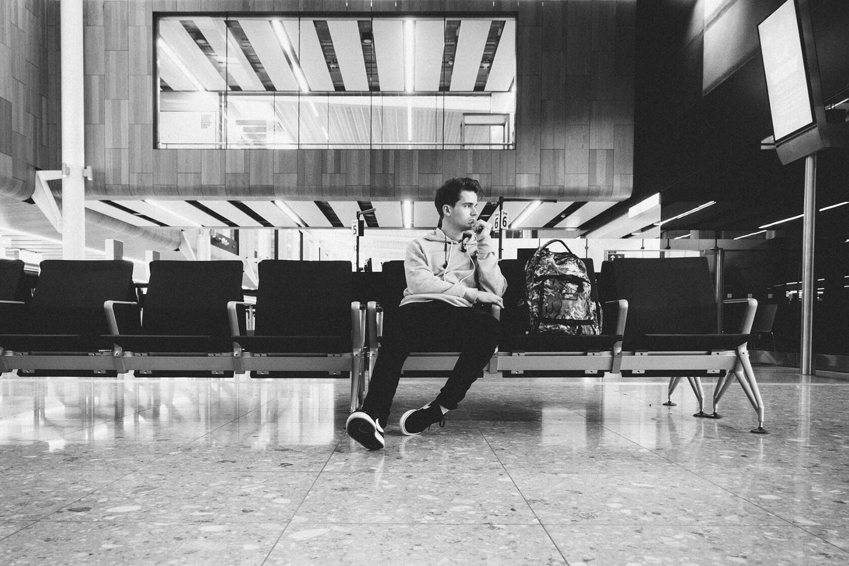black and white photo of the author sitting in an airport thinking