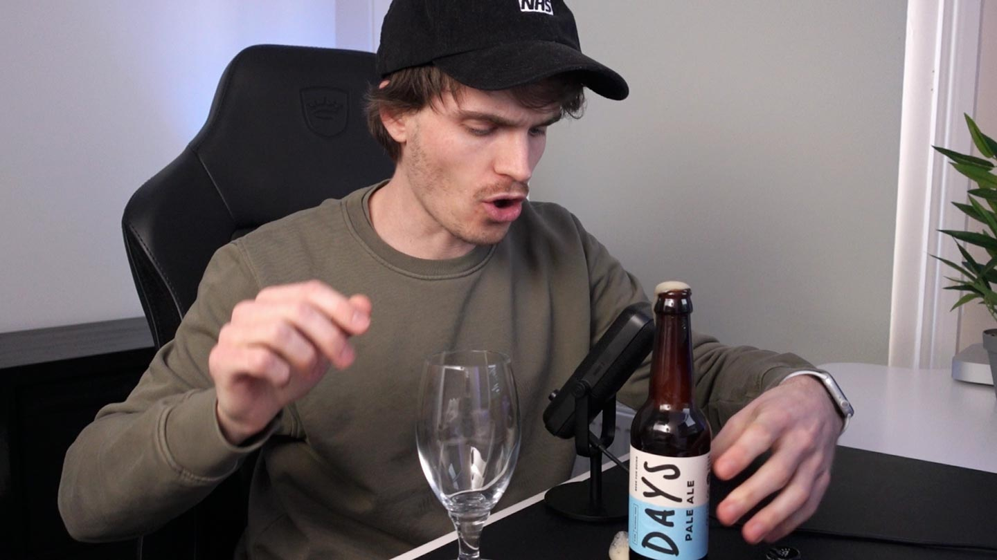 author opening beer and beer spilling on the desk
