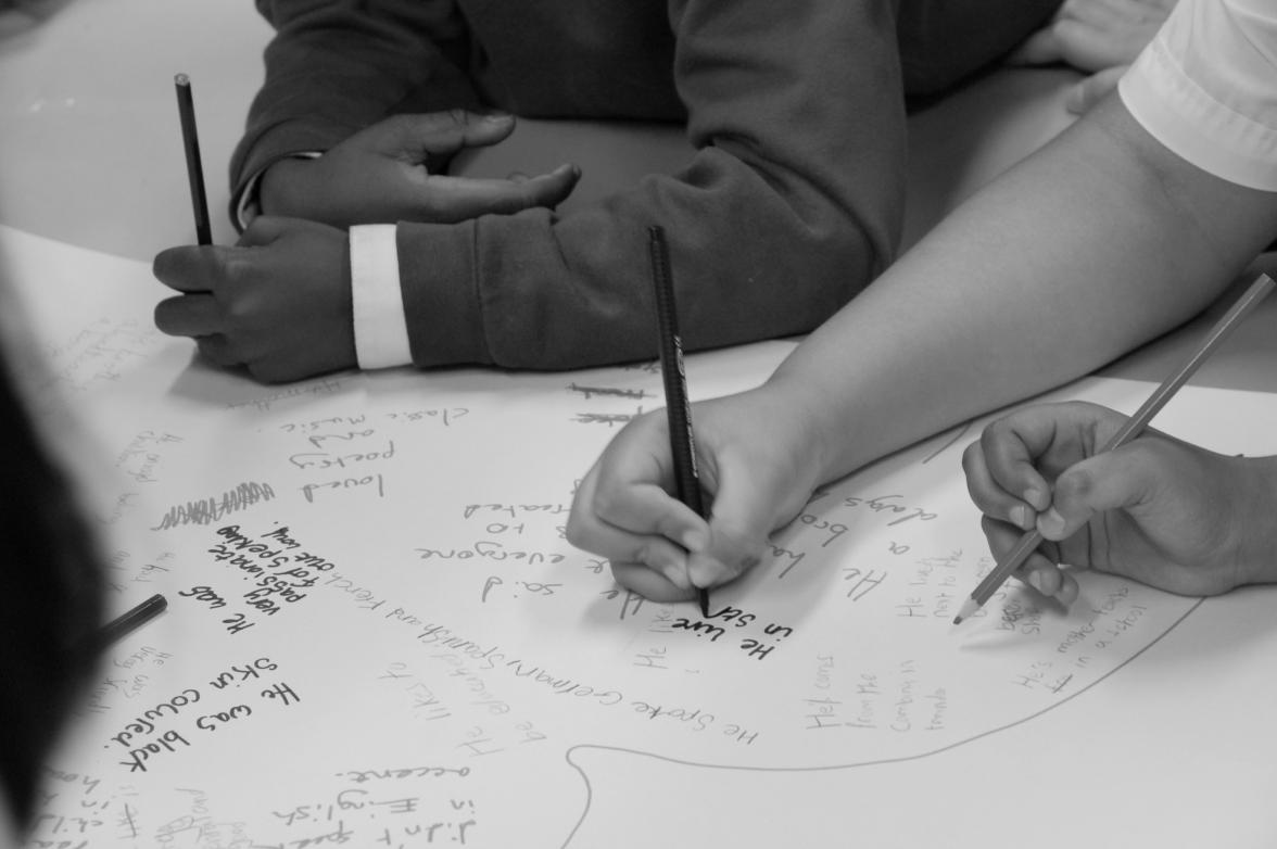 Children's hands writing messages