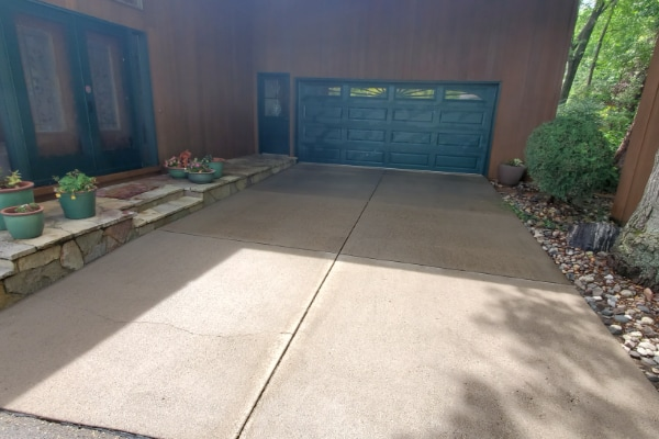 residential driveway cleaned by pressure washing