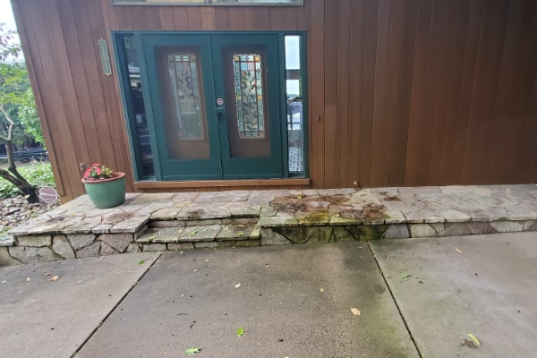 residential patio before cleaned by pressure washing