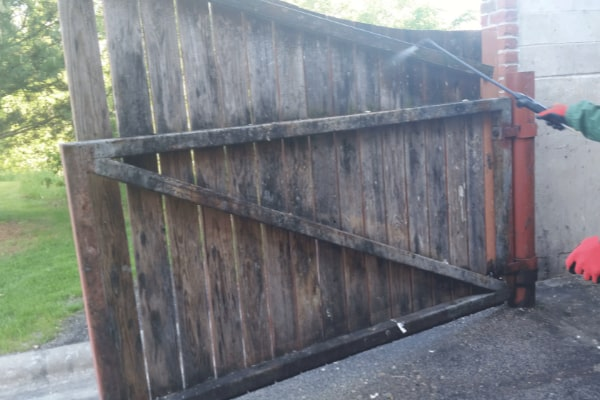 dumpster area before cleaned by pressure washing