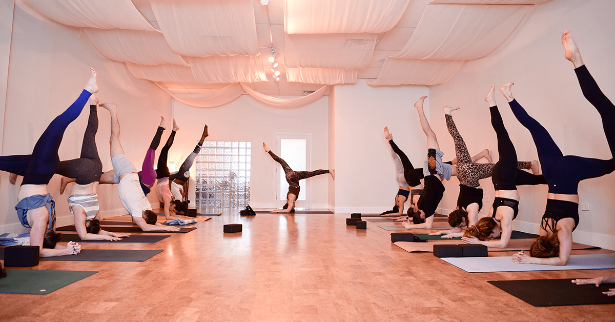A yoga class working on inversions
