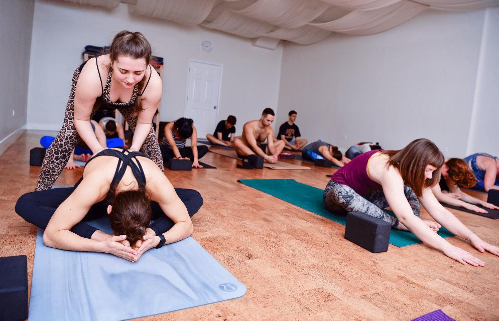 Big Shoulders Yoga Instructor hands-on adjustments and assist