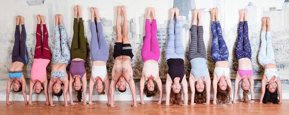 Yoga teachers in handstand