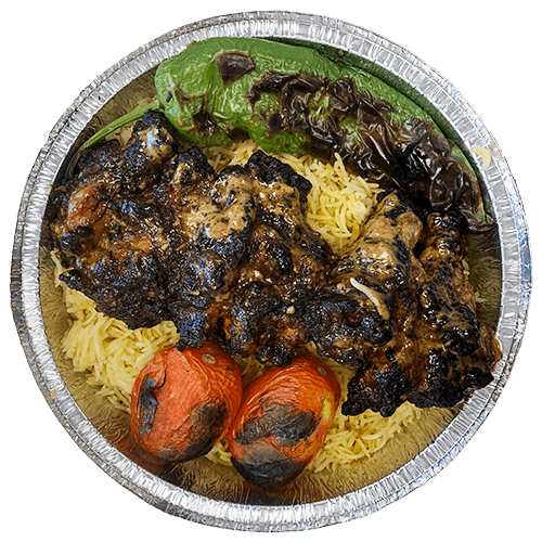 An image of grilled chicken wings on a bed of Saffron Basmati Rice with two grilled tomatoes and a grilled Poblano pepper.