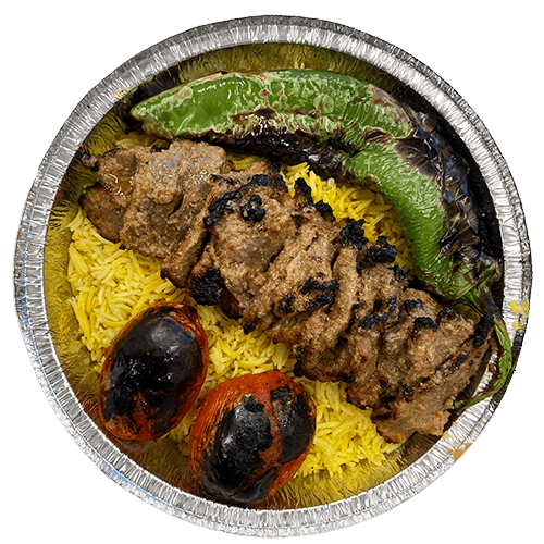 An image of grilled Beef Barg on a bed of Saffron Basmati Rice with two grilled tomatoes and a grilled Poblano pepper.