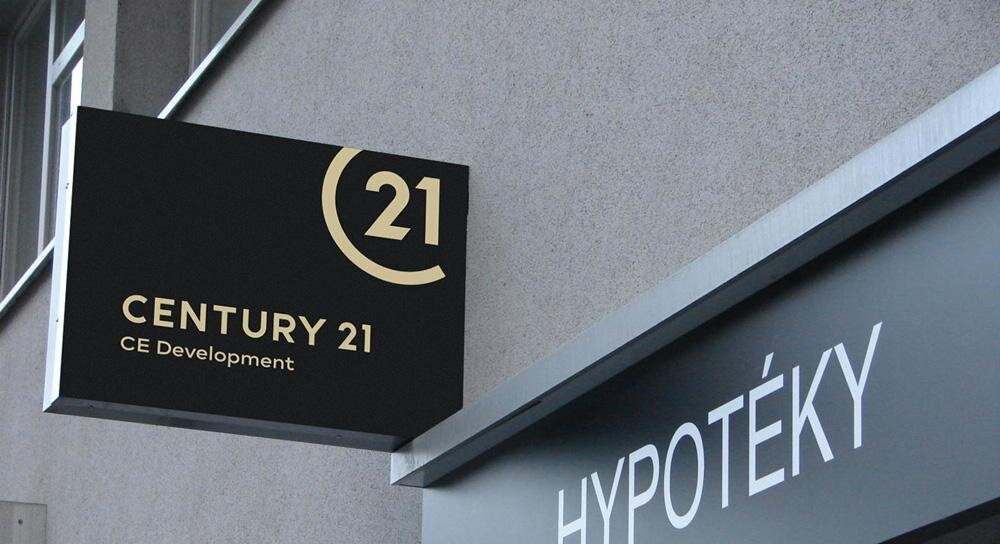 Century 21 Outdoor Signage. Source:  The Close