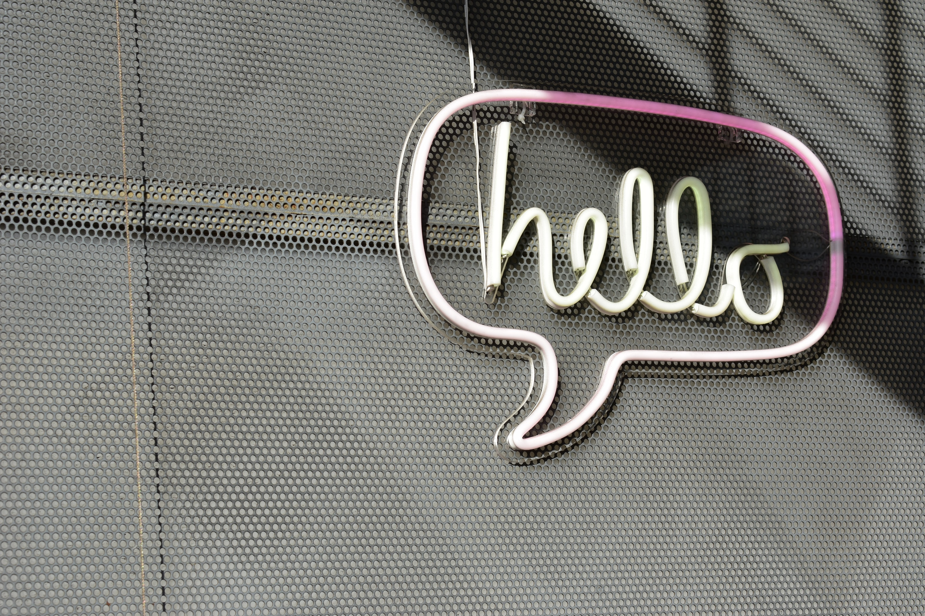 A neon sign of the words hello