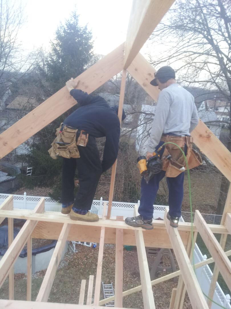 NJPB men framing roof