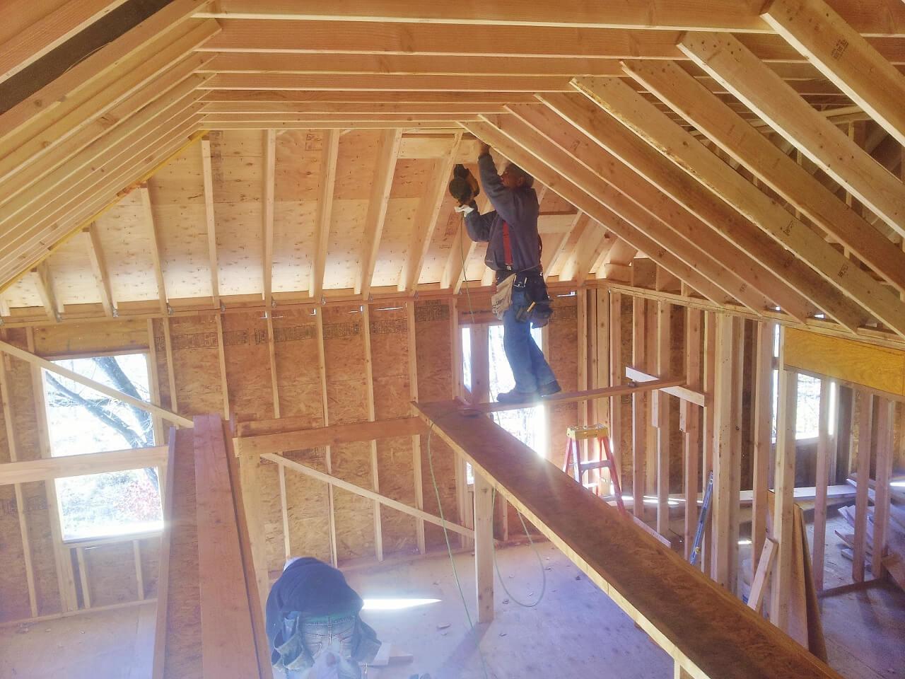 NJPB framing roof - worker on beam