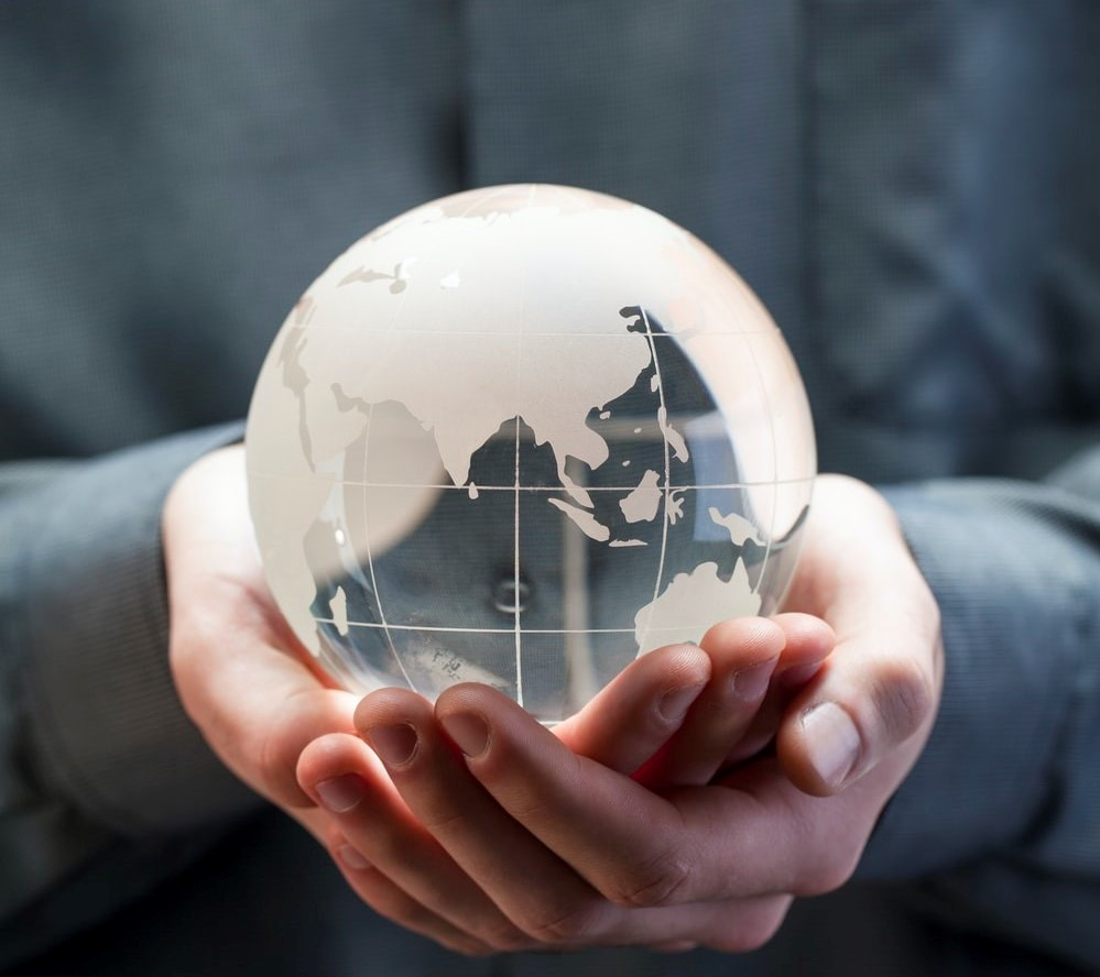 a person holding the globe