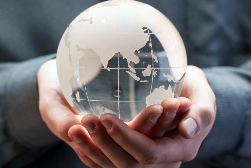 a person holding a globe