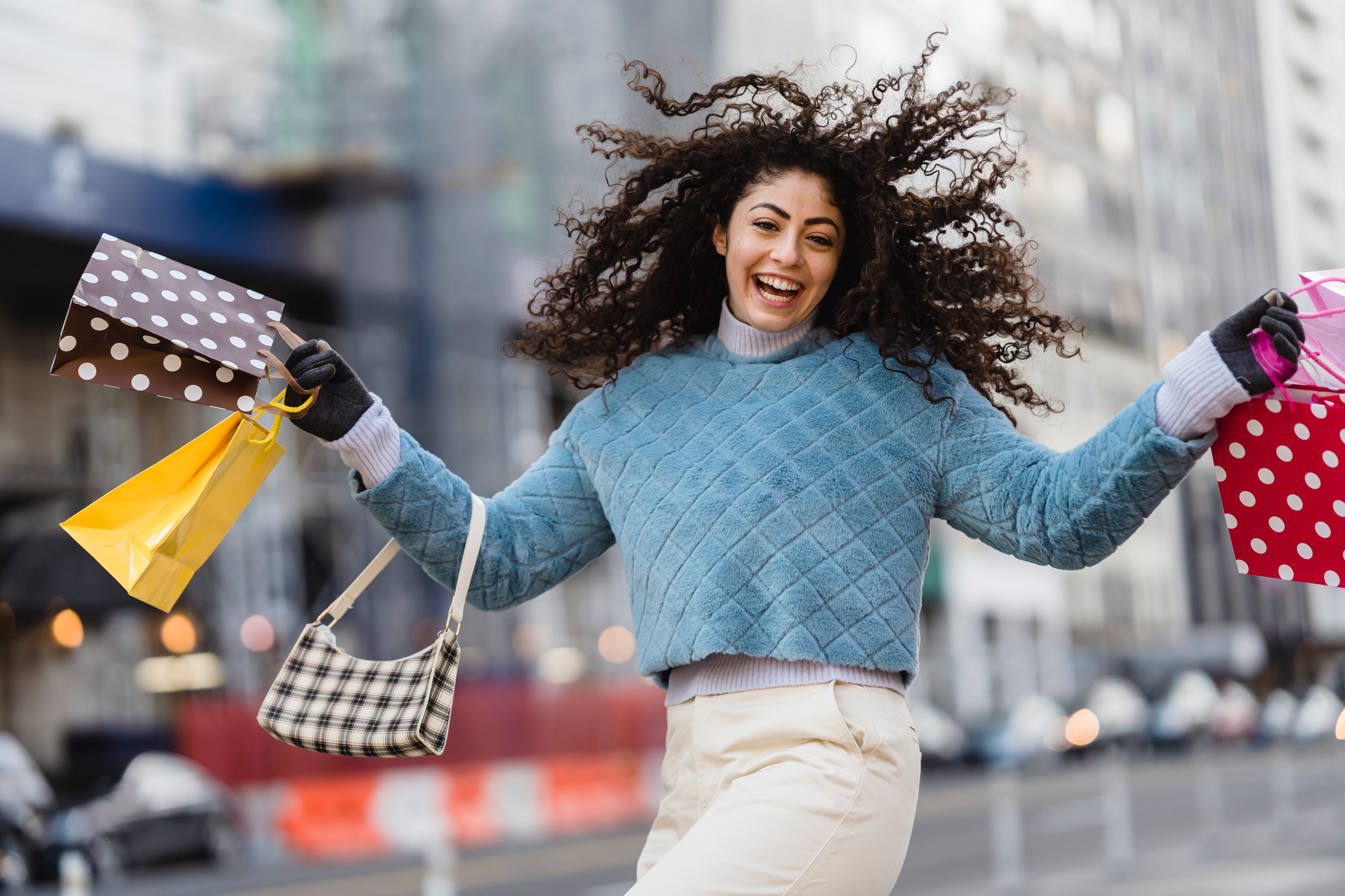 A happy woman with shopping bags