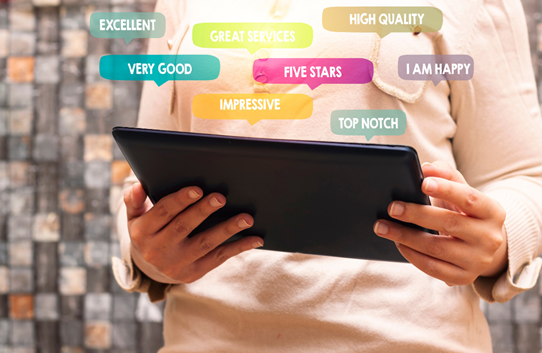 A person using a tablet to assess customer service experience
