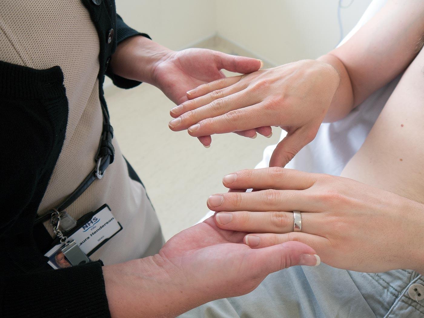 Inspect the patient's hands