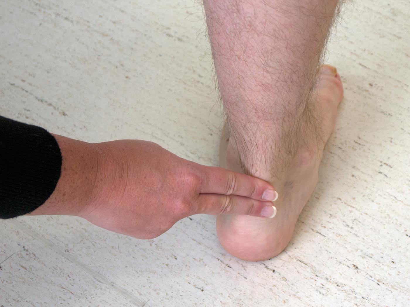 Feel the Achilles tendon for any thickening or swelling