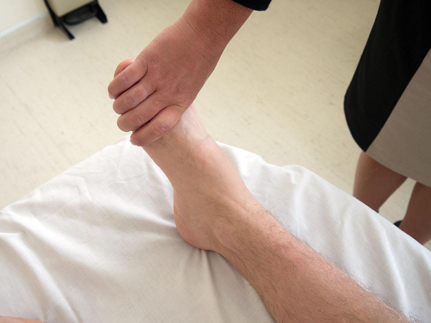 Squeeze the metatarsophalangeal joints