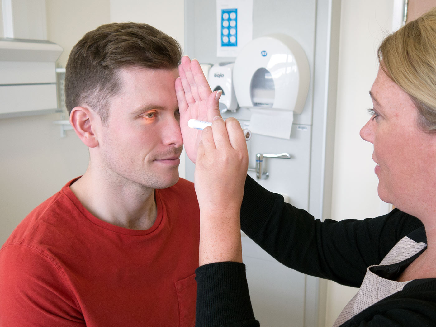 Shine a pen torch into the patient's eye