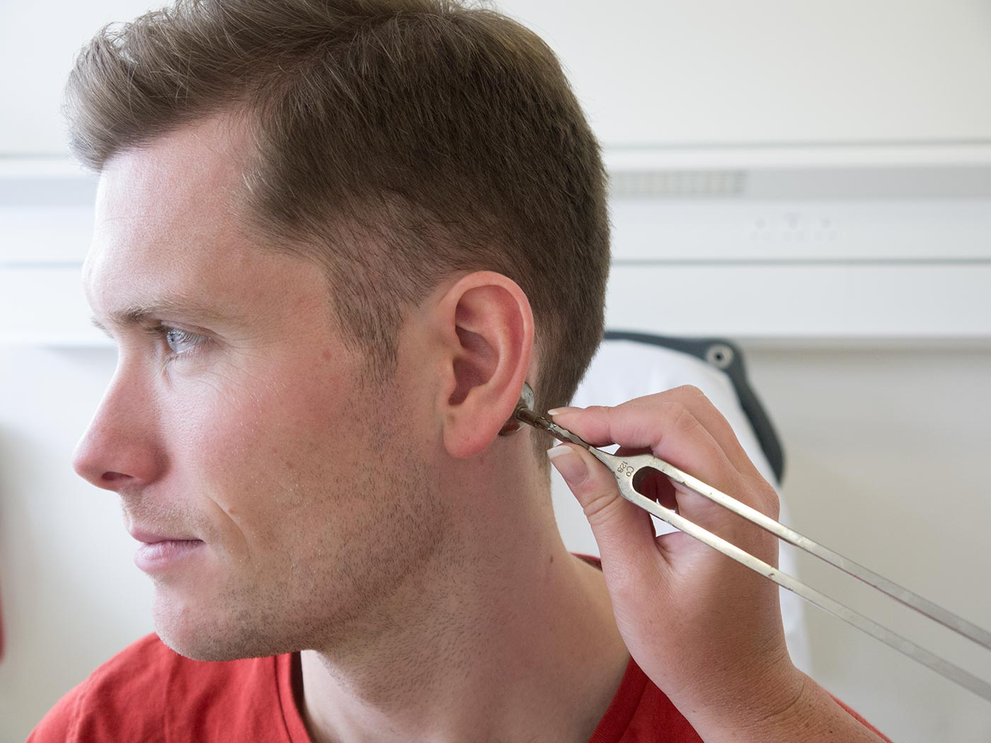 Rinne test - place tuning fork on the mastoid process